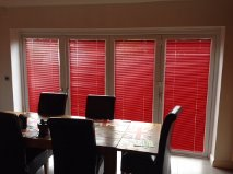 Red INTU Venetian Blinds