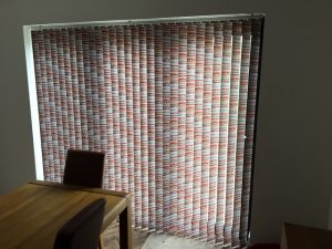 Vertical bi fold door blinds