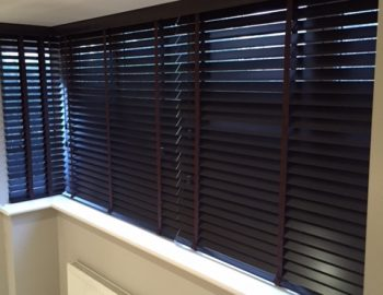 Attractive venetian blinds fitted in a square bay window